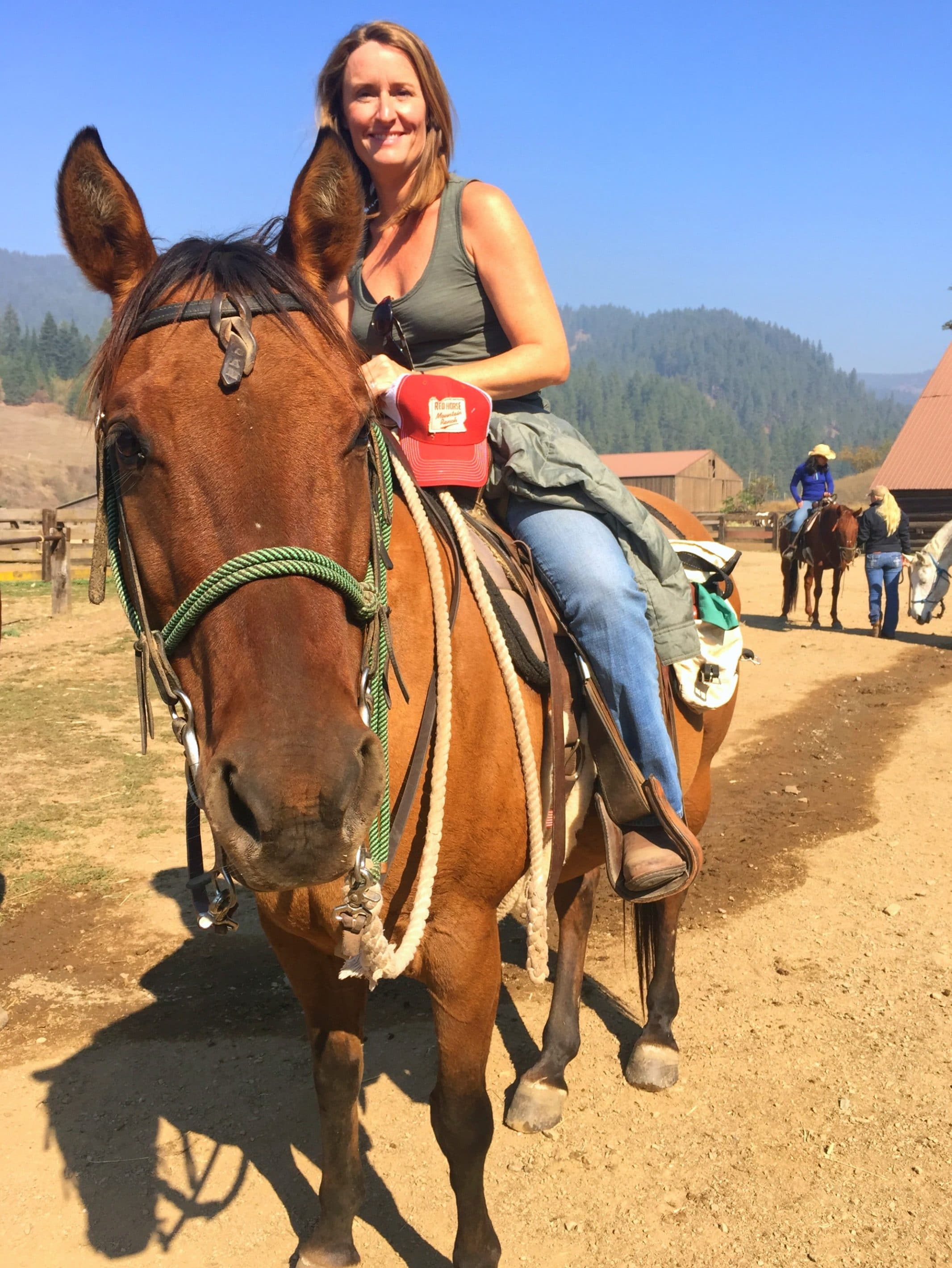 Guests enjoy daily horseback riding lessons and trail rides at Red Horse Mountain Ranch.