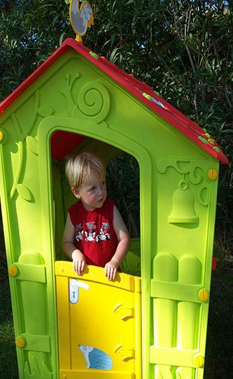 skiathos-princess-playing-in-the-hotel's-outdoor-children's-play-area