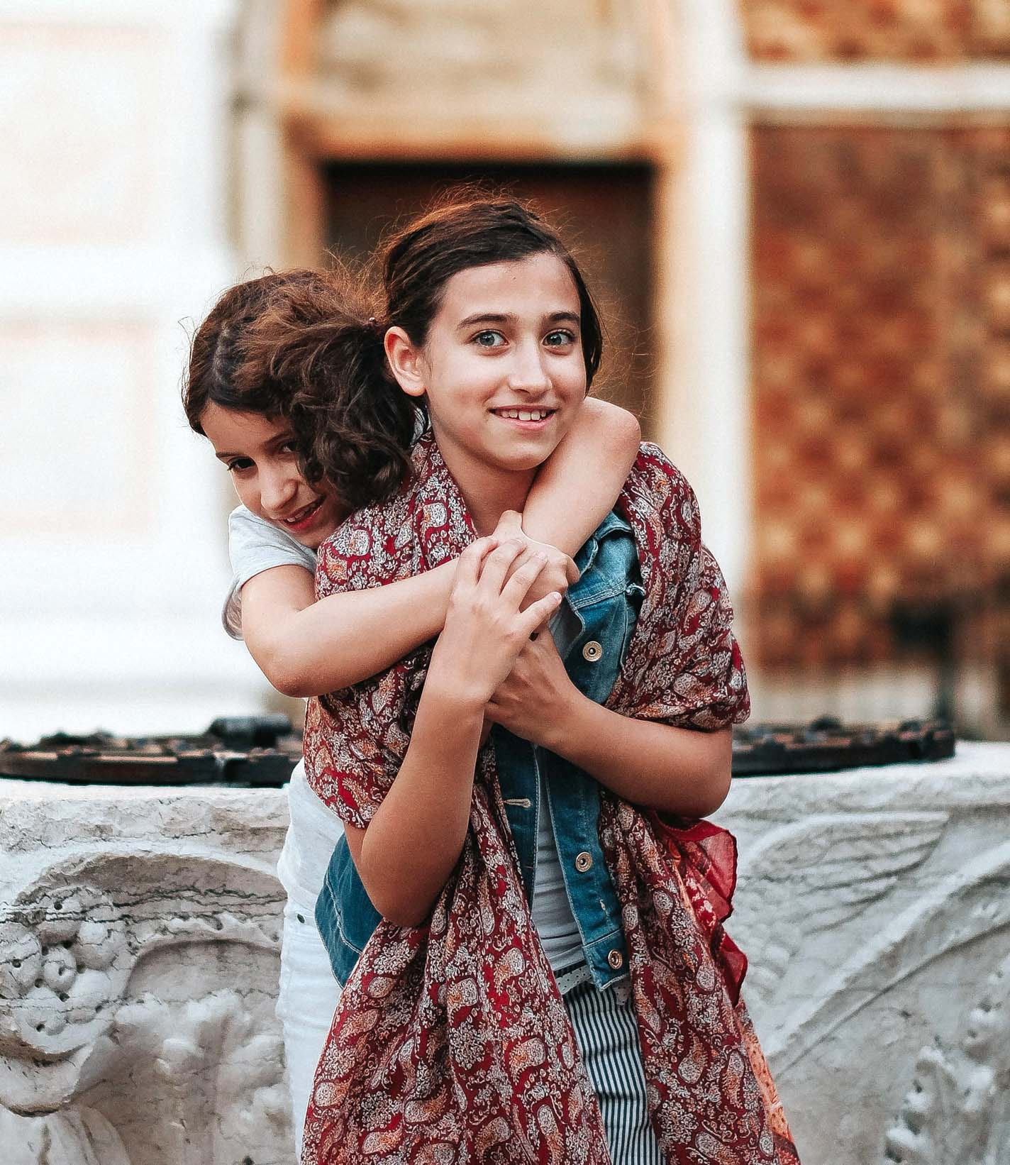 Two girls hugging in Morocco